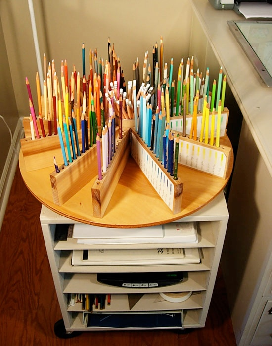 DIY Lazy Susan Wooden Colored Pencil Holder: Create your own colored pencil caddy with a little woodworking magic. You can even put a container in the middle to hold all your other supplies.