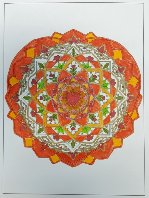 The love mandala from Inkspirations: Love by Design colored by the author, Arielle Ford