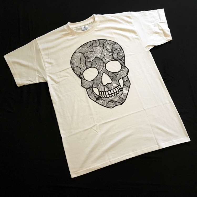 Doodlr Coloring Tshirt in Skull. These colorable clothes, aprons, tote bags, and pillow covers by ShirtBox make awesome gifts!