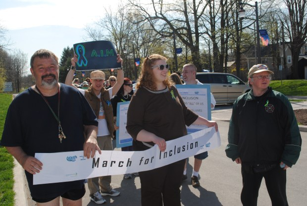 Advocates in Motion March for Inclusion Group with Banner