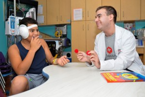 Magician from Magic Aid working with patient at Stony Brook Children's Hospital
