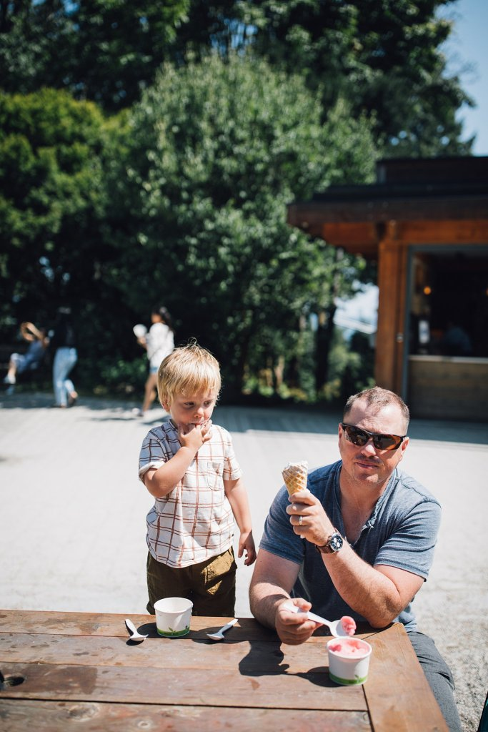 A father and son eating ice cream