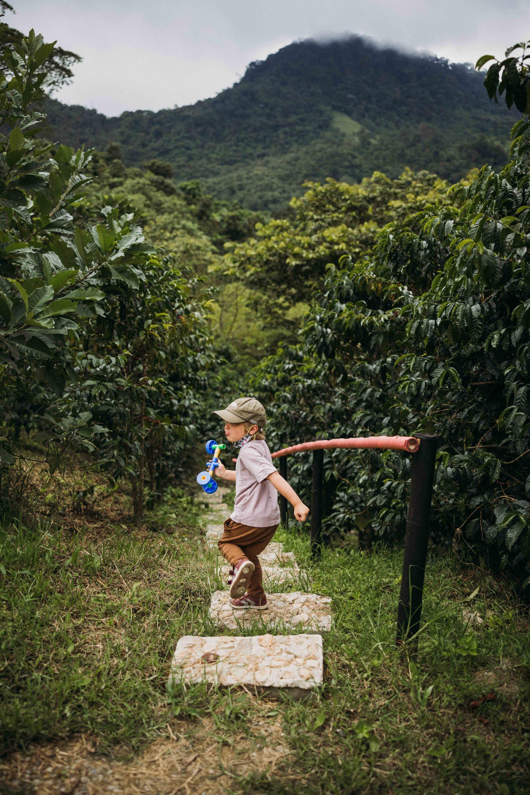 Kid walking down steps outside of Bogota