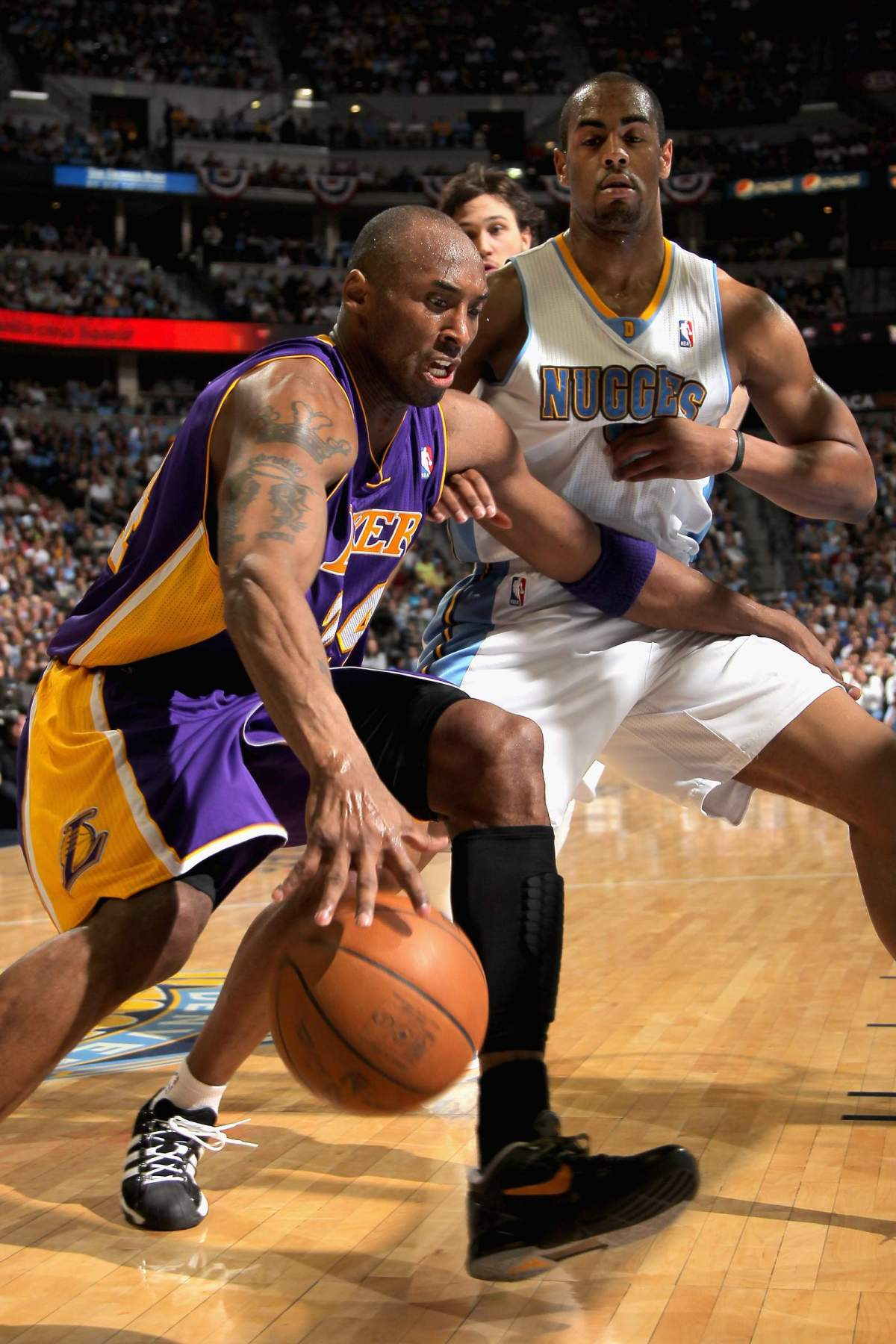 Kobe Bryant drives against Arron Afflalo of the Denver Nuggets in Game 4 of the Western Conference Quarterfinals in the 2012 NBA Playoffs at Pepsi Center.
