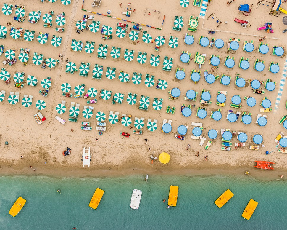The colourful umbrellas create amazing geometric patterns which contrast dramatically with the golden sand and azure-coloured sea. From the air it is possible to see how almost every inch of sand is used on a busy summer's day on the Adriatic coastline.