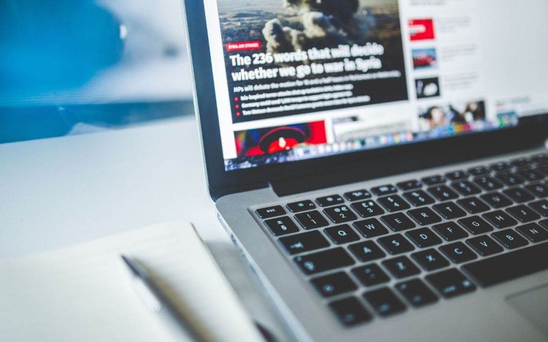 Photo of news website on a laptop computer