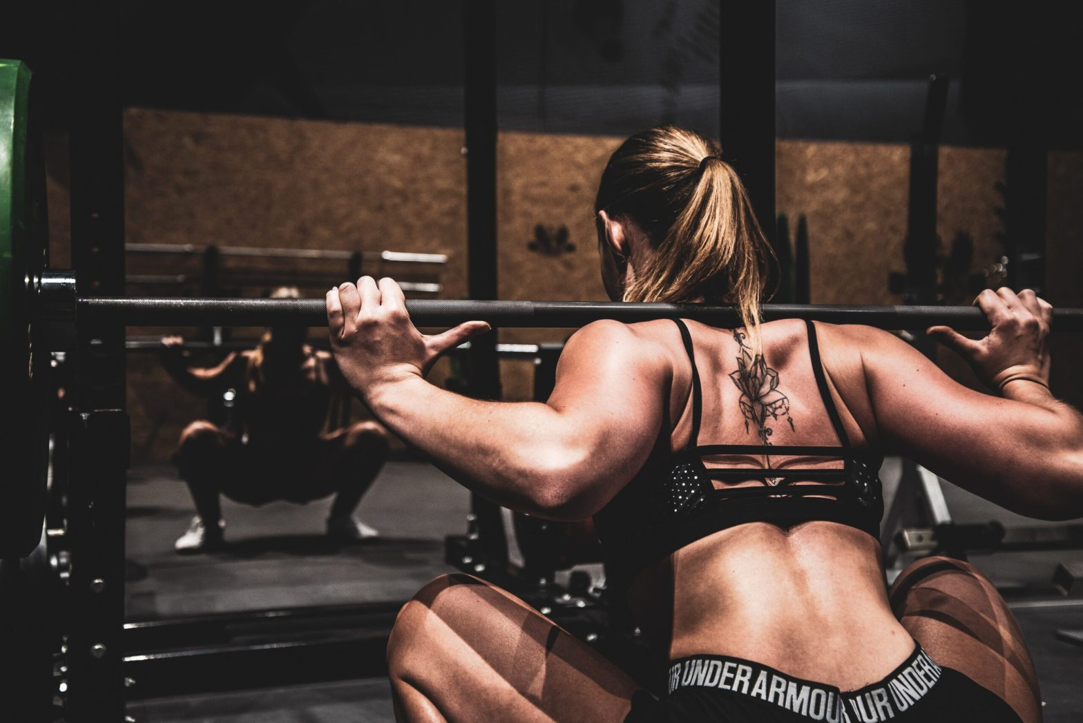 Bulky woman lifting heavy weights
