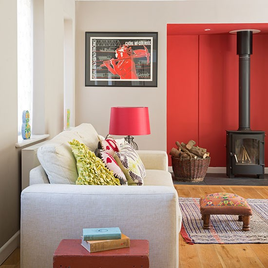 cosy living room with red feature wall living room
