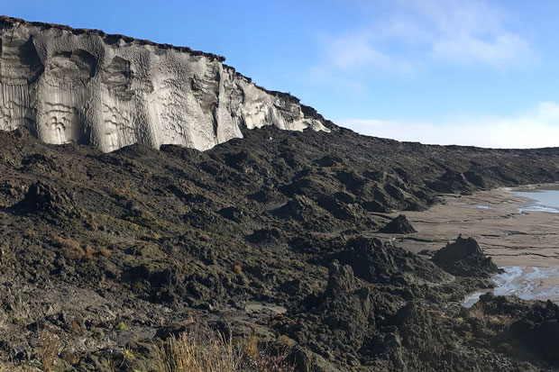 Photograph of an icy bluff on the Alaska Coast with piles of soil at the foot where permafrost has thawed {focus_keyword} Reporting on the State of the Climate in 2018 2018 09 17 ItkillikBluffs Bob usey 620
