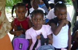 Kids displaying school bags provided by LIME