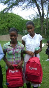 An appreciative duo showing off their Digicel bags