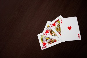King, Queen, Jack and Ace of Hearts Playing Cards on a Table