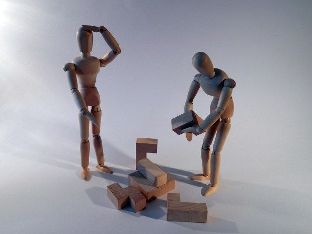 Wooden stick men using building blocks
