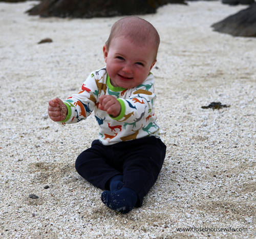 Little man dancing in the sand