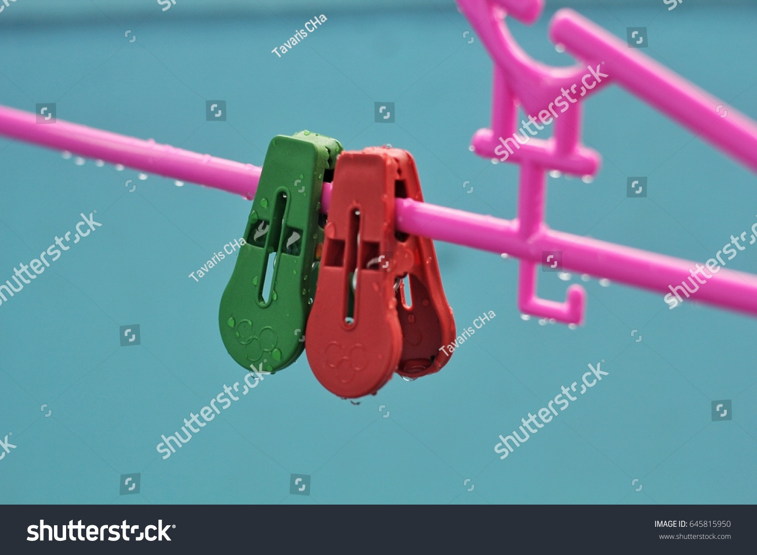 Two Little Clothes Pins on a Clothes Hanger