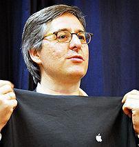 Dan Lyons, aka Fake Steve Jobs, holding up an ...