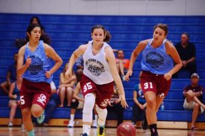 Photo by Nick Baker/ Clovis West's Landynn Munster dribbles down court during the City's 74-63 victory over the County in the City/County All-star basketball game played on June 24.