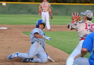 Photo by Nick Baker Clovis High's Tevin Mitchell slides into third against Buchanan. Mitchell capped off his senior year by being selected to Cal-Hi Sports baseball first team and will be attending Cal State Santa Barbara next season.