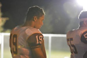 Photo by Jennifer Kelly Faith is an important part of Caleb Kelly's life, seen here praying before a 2014 football game.