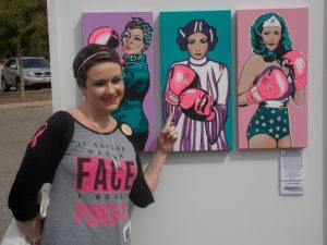 By J.M. Swezey Jenna Kieckhaefer stands next to her painting of Princess Leia of Star Wars, taking a jab against breast cancer