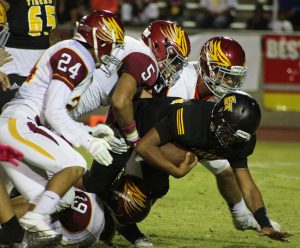 Photo by Nick Baker  The Clovis West defensive unit played extraordinary in the shutout win against Edison. Here, No. 24 Isack Espana, No. 5 Johnny Rojas III and a few Eagle teammates drag an Edison player to the ground.