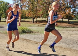 Photo by Nick Baker X-Country Clovis North's Lauren Moffett, who later signed a National Letter of Intent with Vanderbilt, easily wins the TRAC individual title, including her closest competitor Mikayla Sodersten, who battle shin splints all race.