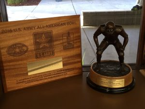 Photo courtesy of Clovis West It's been quite a year for Caleb Kelly; shown here is the official plaque from the U.S. Army All-American Bowl and the Butkus Award.