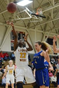 Photo by Nick Baker Clovis West senior Ashley Cross drives for a layup in the Golden Eagles 62-27 victory over Clovis and finish the TRAC with a perfect 10-0 record. The Golden Eagles are currently ranked No. 12 in the nation with an overall record of 26-3.