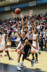 Photo courtesy of Nick Baker  Clovis East's Jaime Atondo flips one up against Central in his team's 66-55 loss to the Grizzlies in the D-1 semi-finals.