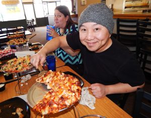 Photo by Ron Sundquist Billy Xiong gets ready to sample The Rodeo pizza.