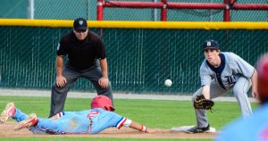 Photo by Nick Baker Alex Peralta of Buchanan dives back to first base against Bullard. Peralta, a senior outfielder, is hitting .347 on the season with 23 runs scored.