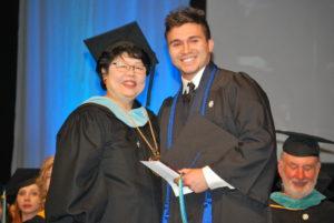 Deborah Ikeda with president's award recipient Sergio Perez.