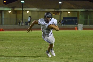 Clovis North senior quarterback Brent Bailey, who scored earlier on a 34-yard touchdown run, turns up field against Sunnyside in the team's 30-6 opening season win. [Photo by Nick Baker]