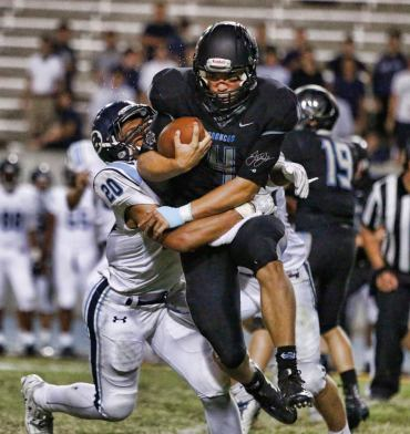 Clovis North quarterback Brent Bailey fights for some tough yards against Bellarmine Prep in the Broncos' 32-21 loss. [Photo by DeAnna Turner]