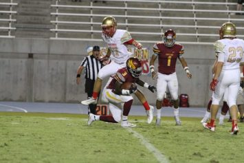 Clovis West's No. 3 Tykee Woods catches a pass on one knee while teammate Rodney Wright Jr., No. 1, watches. The Golden Eagles take on Edison Sept. 9. [Photo by Lynette Daniel]