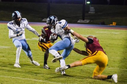 Clovis West's No. 3 Tykee Woods (who also had a key interception in the fourth quarter) and No. 41 Thomas Curran tackle a Bullard ball-carrier in the team's 31-27 nonleague win over the Knights. [Photo by Nick Baker]