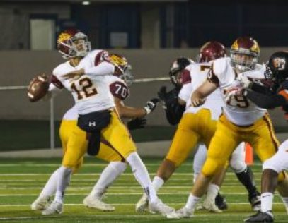 Adrian Martinez of Clovis West throws down field with protection from No. 79 Clive Truschel and No. 70 Isaiah Garcia. Martinez threw for 262 yards and rushed for 142 with four total touchdowns in the semifinal playoff loss. [Photo by Nick Baker]