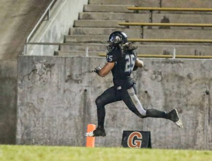 Clovis North's Adam Abajian scores on a 40-yard interception return in the Broncos 49-12 victory over Frontier in the opening round of the playoffs. [Photo by DeAnna Turner]