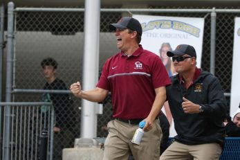 Clovis West head coach Scott Torosian celebrates a goal in his team's 9-7 victory. [Photo by Nick Baker]