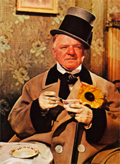 FROM http://en.wikipedia.org/wiki/W._C._Fields: William Claude Dukenfield (January 29, 1880[1] – December 25, 1946), better known as W. C. Fields, was an American comedian, actor, juggler and writer. Fields created a comic persona: a misanthropic and hard-drinking egotist who remained a sympathetic character despite his snarling contempt for dogs, children, and women. The characterization he portrayed in films and on radio was so strong it became generally identified with Fields himself. It was maintained by the movie-studio publicity departments at Fields's studios (Paramount and Universal) and further established by Robert Lewis Taylor's 1949 biography W.C. Fields, His Follies and Fortunes. Beginning in 1973, with the publication of Fields's letters, photos, and personal notes in grandson Ronald Fields's book W.C. Fields by Himself, it has been shown that Fields was married (and subsequently estranged from his wife), and he financially supported their son and loved his grandchildren. However, Madge Evans, a friend and actress, told a visitor in 1972 that Fields so deeply resented intrusions on his privacy by curious tourists walking up the driveway to his Los Angeles home that he would hide in the shrubs by his house and fire BB pellets at the trespassers' legs. Groucho Marx told a similar story on his live performance album, An Evening with Groucho.