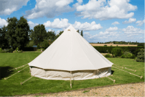 5m-Bushcraft-Bell-Tent-from-behind-in-garden