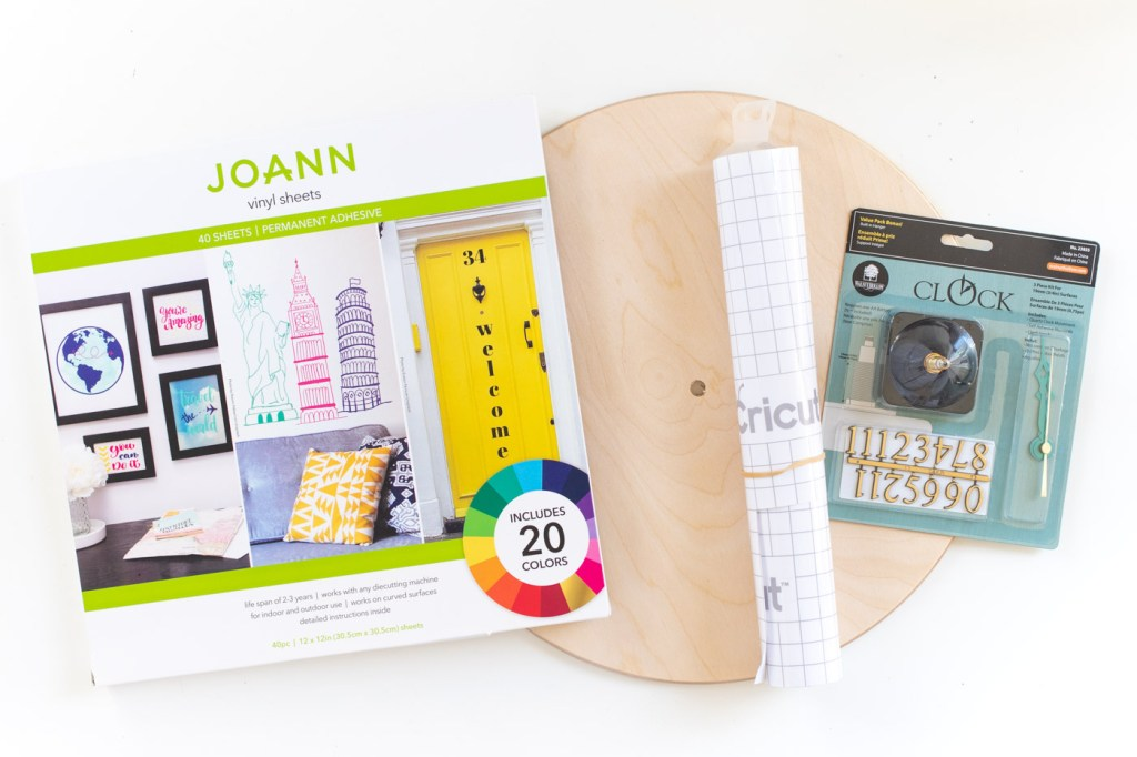 DIY Terrazzo Clock with Vinyl (Free SVG Template!) // Use your Cricut or Silhouette machine to add a colorful terrazzo pattern to a wooden clock with @joann branded adhesive vinyl packs! Simply cut and layer for a unique pieces of wall art using this free cut template! #handmadewithjoann #vinyl #freetemplate #wallart #homedecor #diydecor #terrazzo #cricutmade