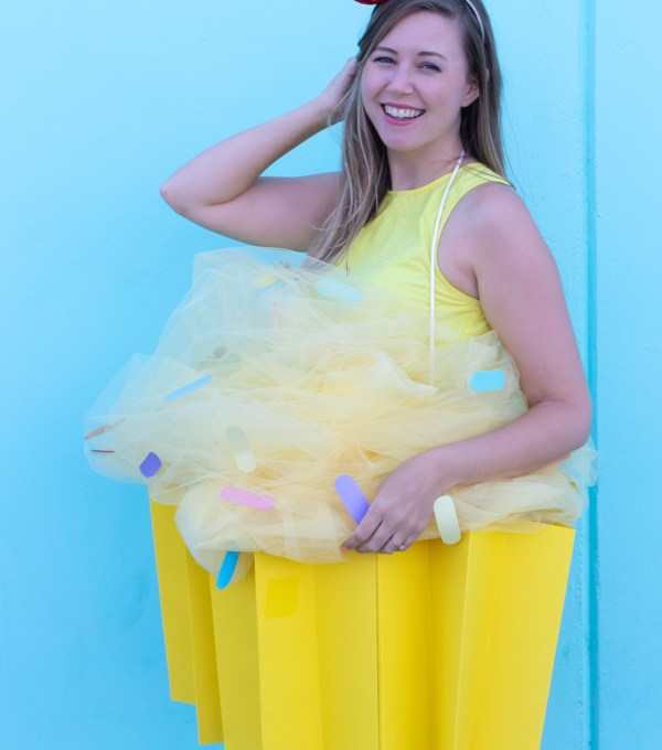 DIY Cupcake Costume for Halloween // Make yourself into a cupcake for Halloween with this fun DIY costume for kids or adults using poster board and tulle! #diycostume #halloween #kidscostumes #adultcostumes #cupcake #halloweendiy #halloweencostume