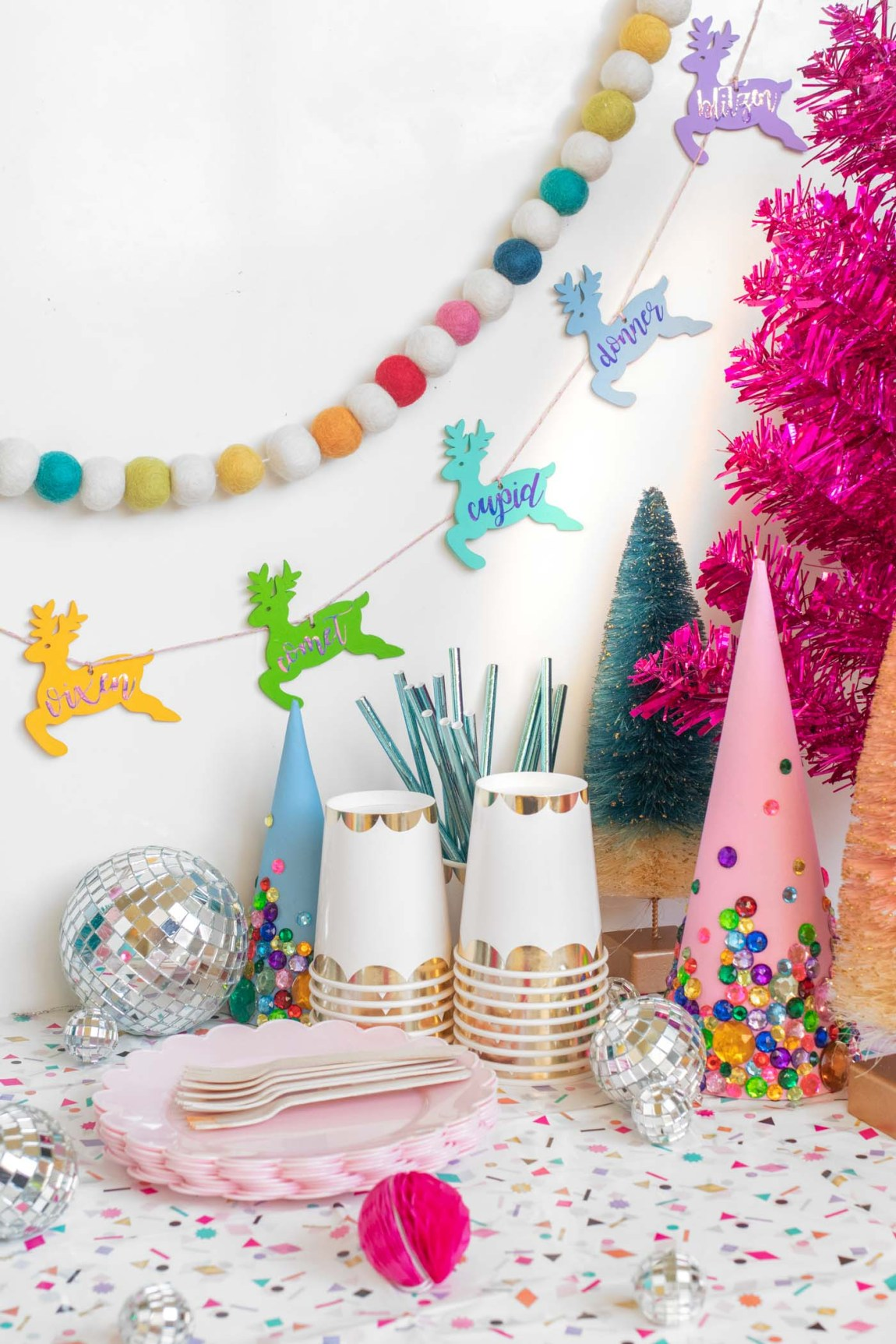 DIY Rainbow Reindeer Garland for Christmas // Paint wooden reindeer ornaments and add holographic vinyl to make a colorful Christmas garland with the names of Santa's reindeer! #christmasdecor #christmas #christmasdiy #rainbowdiy #reindeer #vinyl #cricut #painting