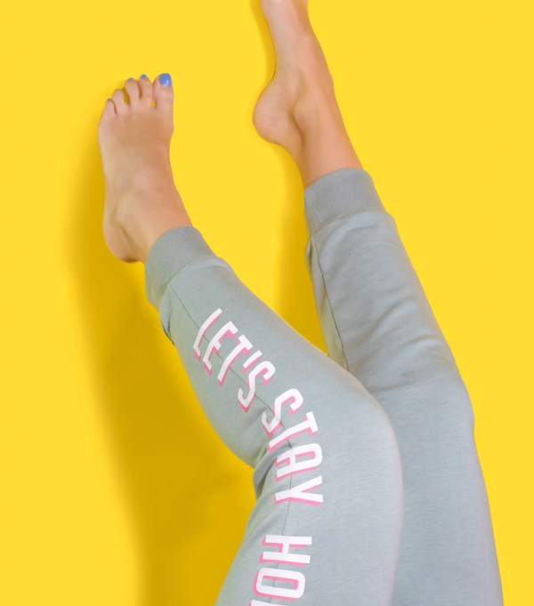 """Let's Stay Home"" DIY Graphic Sweatpants with Iron-On Vinyl (Cricut) // Update a pair of plain sweats with a cute saying using vinyl! #cricutmade #ironon #vinyl #fashion #diyfashion #nosew #sweatpants #womensstyle #stylediy"