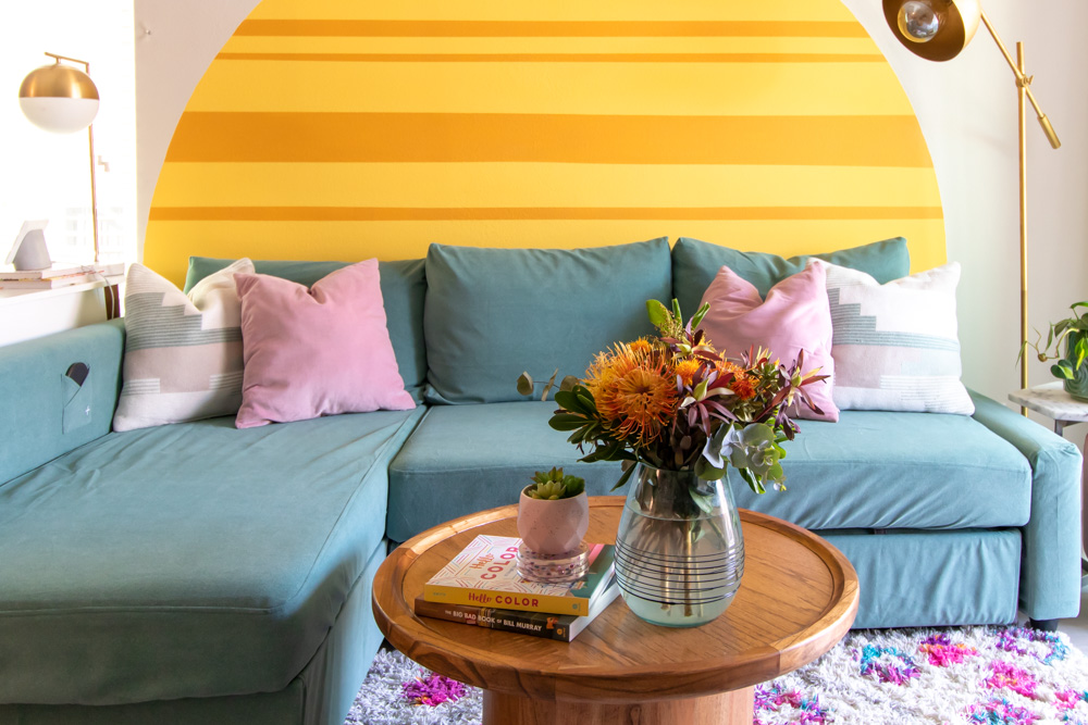 horizontal view of renter-friendly living room with IKEA Friheten sofa update