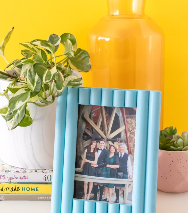 easy photo frame update with trim on table with plant