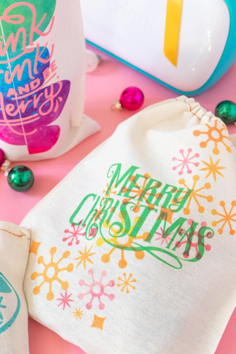 closeup of retro text design on holiday gift packaging with Cricut Joy