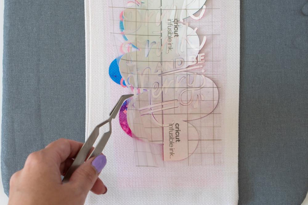 peeling away background of Infusible Ink