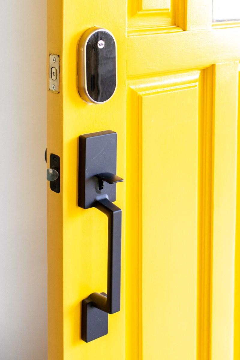 modern front door hardware on bright front door